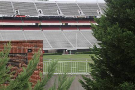 View of Sanford Stadium through the trees, via Geolocations