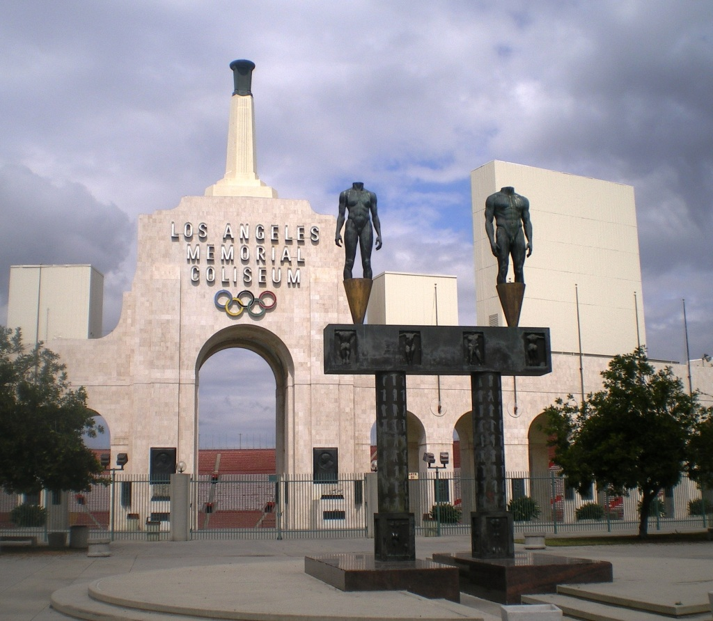 The main Coliseum entry and two bronze statues flanking it, via Archinform