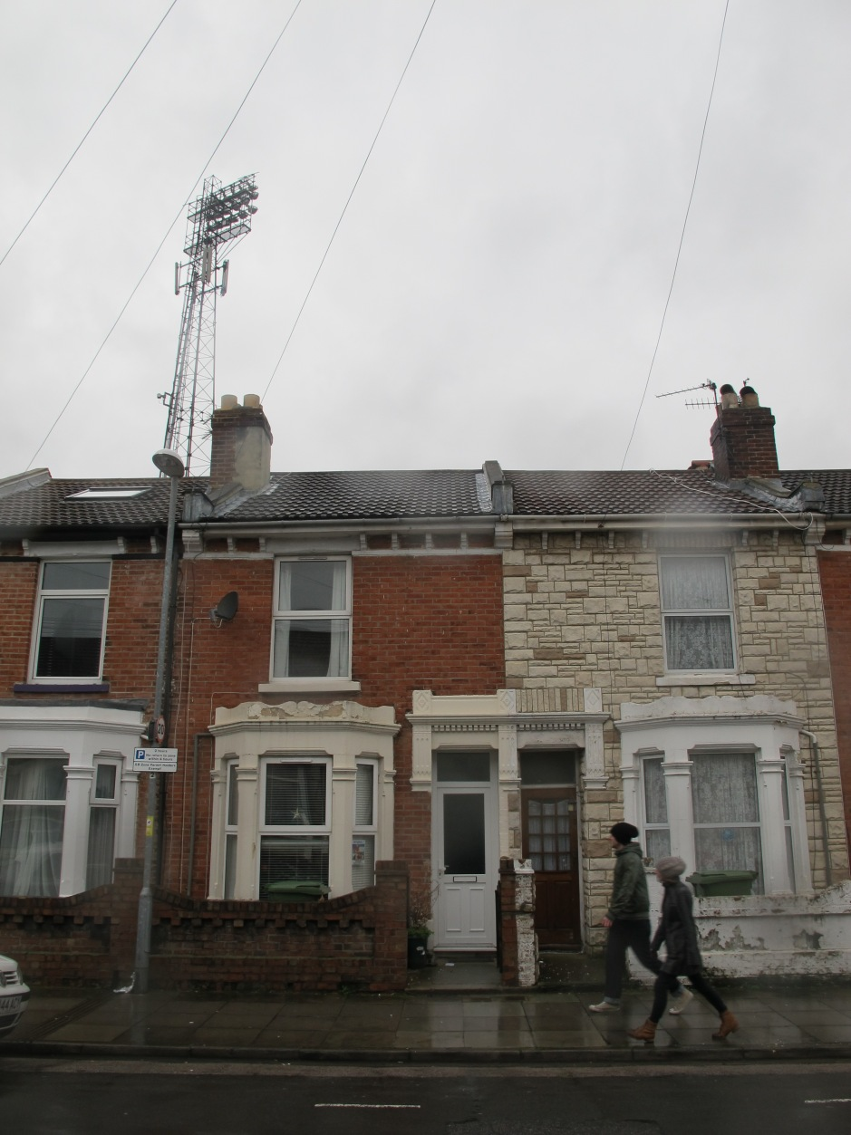 Houses on Carisbrooke Road back onto Fratton Park.