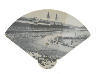 As the fan unfolds, the extent of Churchill Downs magically unfolds with it. The iconic towers designed by architect Joseph Dominic Baldez in 1895 anchor the frantic action on the track and in the stands (Photo: Stadiafile)