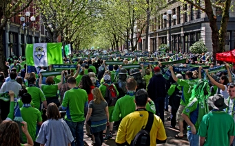 Seattle's 'March to the Match': Fans gather in nearby Occidental Park to sing, chant and revel their way to the game – it's passionate, it's loud and it's 100% American soccer. [Century Link Field, Seattle, WA/Capacity: 38,300/Club: Seattle Sounders FC] (Photo: Emerald City Supporters)