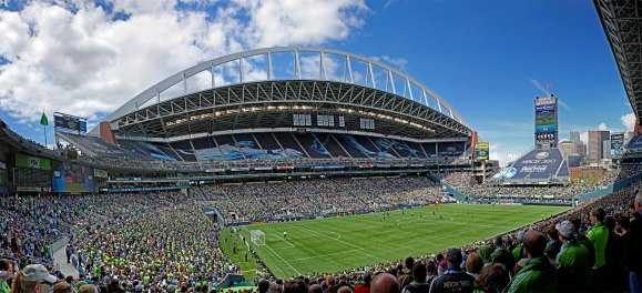 LARGE, URBAN FAN BASES: Soccer is a suburban sport in America, but in Seattle it's urban and its fan base large. Century Link Field is shared with the NFL's Seahawks, but the Sounders regularly fill the large ballpark with 60,000+ on match days. (Photo: Emerald City Supporters)
