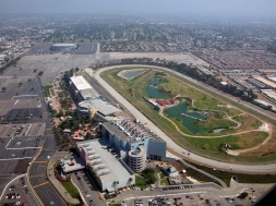"Aerial view of Hollywood Park racetrack with historic LA Forum in background (Photo: ""Hollywood Park"" by Doc Searls - originally posted to Flickr as bos-lax-sba_52.JPG. Licensed under CC BY-SA 2.0 via Wikimedia Commons - http://commons.wikimedia.org/wiki/File:Hollywood_Park.jpg#/media/File:Hollywood_Park.jpg)"