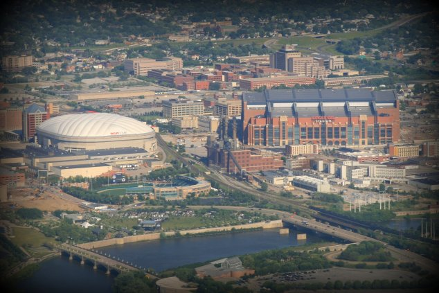 Lucas Oil Stadium (left) replaced the RCA/Hoosier Dome (right). Note how much bigger contemporary stadium are to their modern predecessors (Photo: JFeister on Flickr)